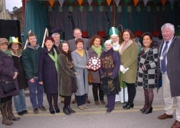 The Parade Press from Uillinn West Cork Arts Centre were the winning float at the St. Patricks Day Parade in Skibbereen, pictured is Catherine O'Callaghan presenting the Julia Hickey Memorial Trophy to Justine Foster and Trisha Curran of the Parade Press with members of Skibbereen Chamber of Commerce, local politicans and St. Patrick and guests  in attendance. Photo: Anne Minihane.